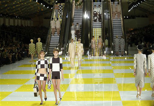 "<div class=""meta image-caption""><div class=""origin-logo origin-image ""><span></span></div><span class=""caption-text"">Models wear creations by fashion designer Marc  Jacobs for Louis Vuitton's ready to wear Spring-Summer 2013 collection presented in Paris, Wednesday, Oct. 3, 2012.  (AP Photo/Jacques Brinon) (AP Photo/ Jacques Brinon)</span></div>"