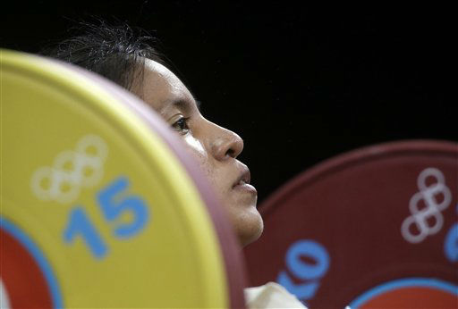 "<div class=""meta ""><span class=""caption-text "">Silvana Saldarriaga of Peru competes during the women's 63-kg weightlifting competition at the 2012 Summer Olympics, Tuesday, July 31, 2012, in London. (AP Photo/Mike Groll) (AP Photo/ Mike Groll)</span></div>"