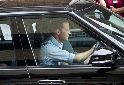 Britain&#39;s Prince William, drives away his wife Kate, Duchess of Cambridge and their son the Prince of Cambridge, Tuesday July 23, 2013, as they leave St. Mary&#39;s Hospital exclusive Lindo Wing in London where the Duchess gave birth on Monday July 22. The Royal couple are expected to head to London?s Kensington Palace from the hospital with their newly born son, the third in line to the British throne. &#40;Photo by Joel Ryan&#47;Invision&#47;AP&#41; <span class=meta>(Photo&#47;Joel Ryan)</span>
