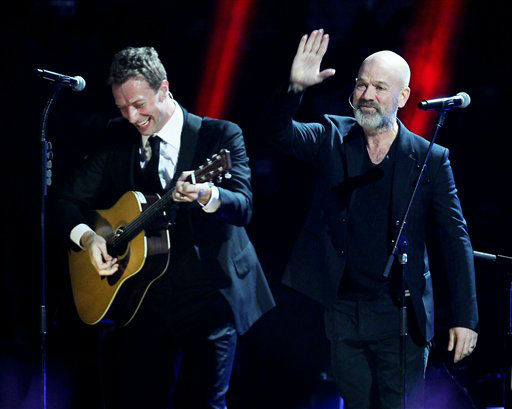 This image released by Starpix shows Chris Martin, left, and Michael Stipe at the 12-12-12 The Concert for Sandy Relief at Madison Square Garden in New York on Wednesday, Dec. 12, 2012. Proceeds from the show will be distributed through the Robin Hood Foundation. &#40;AP Photo&#47;Starpix, Dave Allocca&#41; <span class=meta>(AP Photo&#47; Dave Allocca)</span>