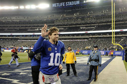 New York Giants quarterback Eli Manning &#40;10&#41; waves to fans after an NFL football game  against the Green Bay Packers Sunday, Nov. 25, 2012 in East Rutherford, N.J. The Giants won the game 38-10. &#40;AP Photo&#47;Bill Kostroun&#41; <span class=meta>(AP Photo&#47; Bill Kostroun)</span>