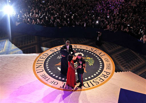 "<div class=""meta ""><span class=""caption-text "">President Barack Obama dances with Air Force Staff Sgt. Bria Nelson as first lady Michelle Obama dances with Marine Corps Gunnery Sgt. Timother Easterling at the Commander-in-Chief's Inaugural Ball in Washington, at the Washington Convention Center during the 57th Presidential Inauguration Monday, Jan. 21, 2013. (AP Photo/Pablo Martinez Monsivais, Pool) (AP Photo/ Pablo Martinez Monsivais)</span></div>"