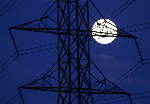 The moon rises behind power lines on Saturday, June 22, 2013, in Nashville, Tenn. The biggest and brightest full moon of the year, called a supermoon, happens as the moon passes closer to earth than usual. &#40;AP Photo&#47;Mark Humphrey&#41; <span class=meta>(AP Photo&#47; Mark Humphrey)</span>