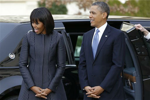 President Barack Obama and first lady Michelle Obama react as they watch their daughters as the first family arrives at St. John&#39;s Church in Washington, Monday, Jan. 21, 2013, for a church service during the 57th Presidential Inauguration. &#40;AP Photo&#47;Jacquelyn Martin&#41; <span class=meta>(AP Photo&#47; Jacquelyn Martin)</span>