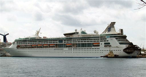 The fire-damaged rear of Royal Caribbean&#39;s Grandeur of the Seas cruise ship is seen while docked in Freeport, Grand Bahama island, Monday, May 27, 2013. Royal Caribbean said the fire occurred early Monday while on route from Baltimore to the Bahamas on the mooring area of deck 3 and was quickly extinguished. All 2,224 guests and 796 crew were safe and accounted for. &#40;AP Photo&#47;The Freeport News, Jenneva Russell&#41; <span class=meta>(AP Photo&#47; Jenneva Russell)</span>