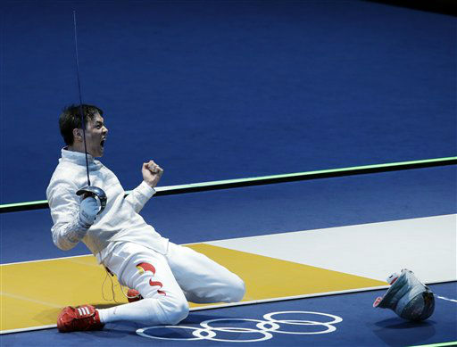 "<div class=""meta image-caption""><div class=""origin-logo origin-image ""><span></span></div><span class=""caption-text"">China's Man Zhong reacts after defeating South Korea's Kim Jung-hwan during the men's individual sabre round of 32 fencing at the 2012 Summer Olympics, Sunday, July 29, 2012, in London. (AP Photo/Andrew Medichini) (AP Photo/ Andrew Medichini)</span></div>"