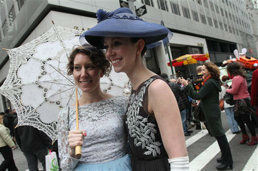 Dressed for the occasion, Juliette Imhof, left, and her sister Michelle Imhof, foreground right, pose for photographs on New York&#39;s Fifth Avenue as they take part in the Easter Parade Sunday March 31, 2013.   <span class=meta>(&#40;AP Photo&#47;Tina Fineberg&#41;)</span>