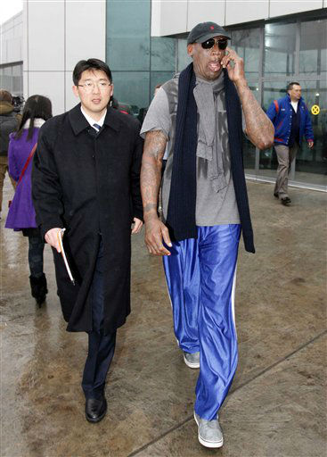 Flamboyant former NBA star Dennis Rodman, right, scratches his face upon arrival at Pyongyang Airport, North Korea, Tuesday, Feb. 26, 2013. The American known as &#34;The Worm&#34; arrived in Pyongyang, becoming an unlikely ambassador for sports diplomacy at a time of heightened tensions between the U.S. and North Korea. &#40;AP Photo&#47;Kim Kwang Hyon&#41; <span class=meta>(AP Photo&#47; Kim Kwang Hyon)</span>