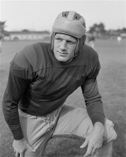 FILE - In this Sept. 17, 1948, file photo, Michigan quarterback Pete Elliott, of Bloomington, Ill., is shown in Ann Arbor, Mich.  Elliott, the longest-tenured executive director in the Pro Football Hall of Fame&#39;s history, has died on Friday, Jan. 4, 102, the hall announced. He was 86. Elliott, an All-American quarterback at Michigan in the 1940s before a long career in coaching, was enshrined into the College Football Hall of Fame in 1994. &#40;AP Photo&#47;Preston Stroup, File&#41; <span class=meta>(AP Photo&#47; Preston Stroup)</span>