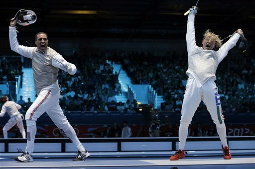 "<div class=""meta ""><span class=""caption-text "">James-Andrew Davis of Great Britain competes against Valerio Aspromonte of Italy, right, during the men's foil team fencing competition at the 2012 Summer Olympics, Sunday, Aug. 5, 2012, in London. Italy beat Great Britain to advance. (AP Photo/Dmitry Lovetsky) (AP Photo/ Dmitry Lovetsky)</span></div>"