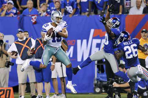 Dallas Cowboys wide receiver Miles Austin &#40;19&#41; catches a pass as New York Giants defensive back Justin Tryon &#40;30&#41; and Antrel Rolle &#40;26&#41; defend during the second half of an NFL football game Wednesday, Sept. 5, 2012, in East Rutherford, N.J. Austin scored a touchdown on the play. &#40;AP Photo&#47;Bill Kostroun&#41; <span class=meta>(AP Photo&#47; Bill Kostroun)</span>