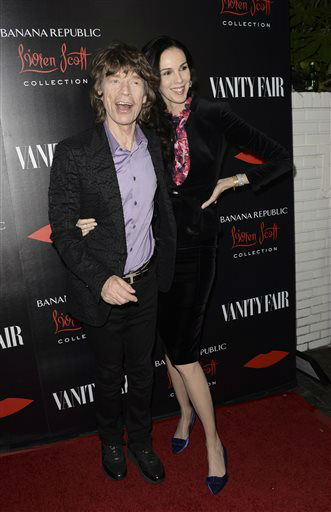 FILE - In a Tuesday, Nov. 19, 2013 file photo, singer Mick Jagger, left, and fashion designer L&#39;Wren Scott arrive at the Banana Republic L&#39;Wren Scott Collection launch party at the Chateau Marmont, in West Hollywood, Calif. L&#39;wren Scott launches the limited-edition Banana Republic L&#39;Wren Scott Collection Wednesday, Dec. 4, 2013, and Scott says it will wrap her signature flattering construction and extraordinary fabrics into a package that will cost less than &#36;200. &#40;Photo by Dan Steinberg&#47;Invision&#47;AP, File&#41; <span class=meta>(Photo&#47;Dan Steinberg)</span>