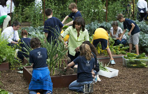 First lady Michelle Obama, center, joins school children from Long Beach Island Grade School in Ship Bottom, N.J., foreground, and others from across the country to harvest the summer crop from the White House kitchen garden in Washington, Tuesday, May 28, 2013.  &#40;AP Photo&#47;Manuel Balce Ceneta&#41; <span class=meta>(AP Photo&#47; Manuel Balce Ceneta)</span>