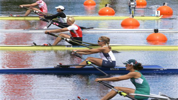Boats from, bottom to top, Mexico, USA, Belarus, Algeria, and Russia, move to the starting line during a women&#39;s rowing single sculls heat in Eton Dorney, near Windsor, England, at the 2012 Summer Olympics, Saturday, July 28, 2012. &#40;AP Photo&#47;Chris Carlson&#41; <span class=meta>(AP Photo&#47; Chris Carlson)</span>
