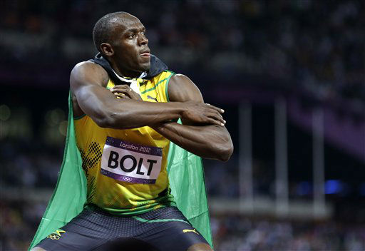 "<div class=""meta ""><span class=""caption-text "">Jamaica's Usain Bolt reacts to his win in the men's 100-meter final during the athletics in the Olympic Stadium at the 2012 Summer Olympics, London, Sunday, Aug. 5, 2012.(AP Photo/Anja Niedringhaus) (AP Photo/ Anja Niedringhaus)</span></div>"
