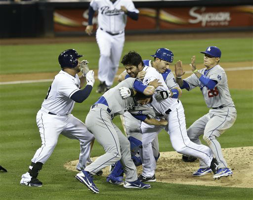San Diego Padres&#39; Carlos Quentin, center, and teammates battle the Los Angeles Dodgers after Quentin was hit by a pitch thrown by Angeles Dodgers  pitcher Zack Greinke  in the sixth inning of baseball game in San Diego, Thursday, April 11, 2013. &#40;AP Photo&#47;Lenny Ignelzi&#41; <span class=meta>(AP Photo&#47; Lenny Ignelzi)</span>