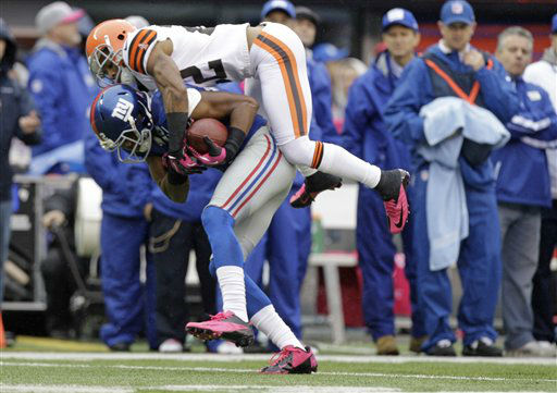 Cleveland Browns defensive back Buster Skrine &#40;22&#41; makes a tackle during the first half of an NFL football game against the New York Giants Sunday, Oct. 7, 2012, in East Rutherford, N.J. &#40;AP Photo&#47;Kathy Willens&#41; <span class=meta>(AP Photo&#47; Kathy Willens)</span>