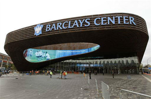"<div class=""meta ""><span class=""caption-text "">Workers sweep the plaza in front of the main entrance to the Barclays Center in the Brooklyn borough of New York, Thursday, Sept. 20, 2012, in preparation for Friday's ribbon-cutting ceremony. A new chapter in Brooklyn's history begins Friday when the Brooklyn Nets' new arena opens. (AP Photo/Kathy Willens) (AP Photo/ Kathy Willens)</span></div>"