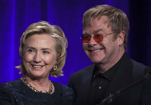 Former Secretary of State Hillary Clinton, left, poses onstage for a photograph with Elton John after receiving her Founders award during the Elton John AIDS Foundation&#39;s 12th Annual &#34;An Enduring Vision&#34; benefit gala at Cipriani Wall Street on Tuesday, Oct. 15, 2013, in New York. &#40;Photo by Carlo Allegri&#47;Invision&#47;AP&#41; <span class=meta>(Photo&#47;Carlo Allegri)</span>