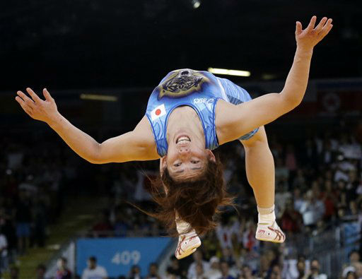 Saori Yoshida of Japan celebrates by doing a backflip after she beat Tonya Lynn Verbeek of Canada for the gold medal during their 55-kg women&#39;s freestyle wrestling competition at the 2012 Summer Olympics, Thursday, Aug. 9, 2012, in London. &#40;AP Photo&#47;Paul Sancya&#41; <span class=meta>(AP Photo&#47; Paul Sancya)</span>