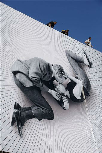 Workers set up a giant 66th Cannes Film Festival official poster at the Cannes Festival Palace, Monday, May 13, 2013. The poster shows Paul Newman and Joanne Woodward kissing, on the set of the film &#39;A New Kind of Love &#39;,  directed by Melville Shavelson in 1963. The Cannes Film Festival will start on Wednesday, May 15. &#40;AP Photo&#47;Lionel Cironneau&#41; <span class=meta>(AP Photo&#47; Lionel Cironneau)</span>