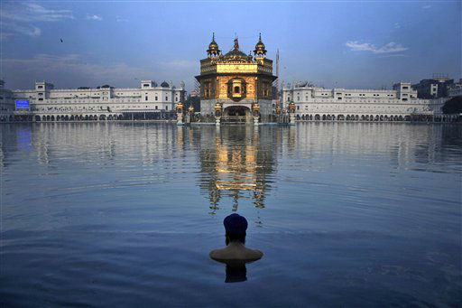 An Indian Sikh devotee takes a holy bath in the sacred pond of the Golden Temple, Sikh?s holiest temple, during the birth anniversary of Guru Nanak, in Amritsar, India, Wednesday, Nov. 28, 2012. Sikhism was founded in the 15th century by Guru Nanak, who broke away from Hinduism, India&#39;s dominant religion. He preached the equality of races and genders, and the rejection of image-worship and the caste system. &#40;AP Photo&#47;Sanjeev Syal&#41; <span class=meta>(AP Photo&#47; Sanjeev Syal)</span>