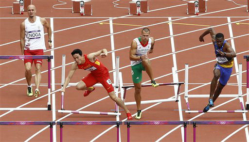China&#39;s Liu Xiang, second left, falls as  Hungary&#39;s Balazs Baji, Poland&#39;s Artur Noga and Barbados&#39; Shane Brathwaite react during a men&#39;s 110-meter hurdles heat during the athletics in the Olympic Stadium at the 2012 Summer Olympics, London, Tuesday, Aug. 7, 2012. &#40;AP Photo&#47;Daniel Ochoa De Olza&#41; <span class=meta>(AP Photo&#47; Daniel Ochoa De Olza)</span>
