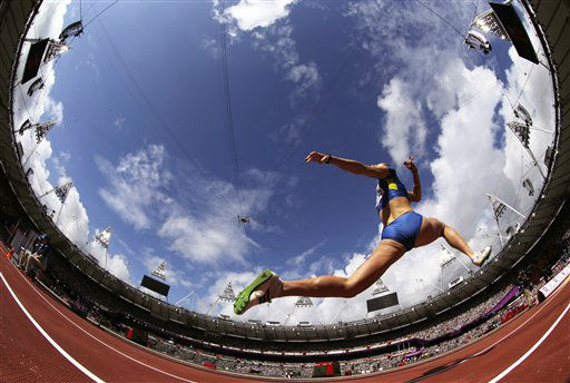In this photo taken with a fisheye lens  Ukraine&#39;s Hanna Demydova makes an attempt in the women&#39;s Triple Jump qualification during the athletics in the Olympic Stadium at the 2012 Summer Olympics, London, Friday, Aug. 3, 2012. &#40;AP Photo&#47;David J. Phillip &#41; <span class=meta>(AP Photo&#47; David J. Phillip)</span>