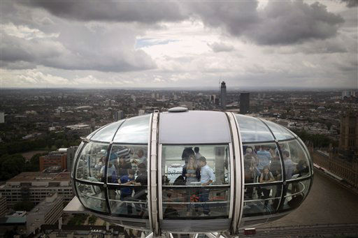 Tourists ride inside a cabin of the London Eye on Thursday, Aug. 2, 2012, in London. &#40;AP Photo&#47;Emilio Morenatti&#41; <span class=meta>(AP Photo&#47; Emilio Morenatti)</span>