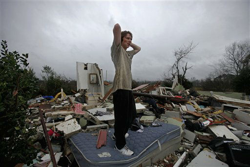 Will Carter, 15, surveys the damage to his house upon arriving home from school following a tornado, Wednesday, Jan. 30, 2013, in Adairsville, Ga. (AP Photo/David Goldman)