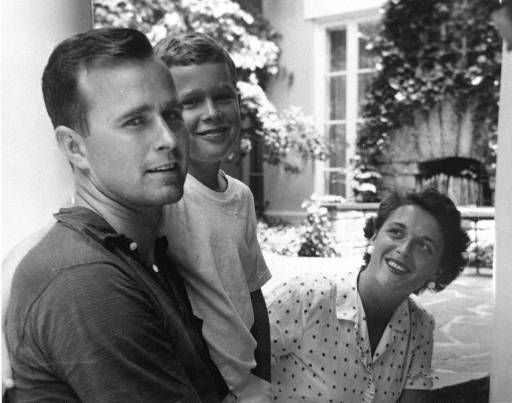 "<div class=""meta image-caption""><div class=""origin-logo origin-image ""><span></span></div><span class=""caption-text"">George W. Bush, center, poses with his father George Bush and mother Barbara Bush in Rye, New York, during the summer of 1955. George W. Bush was born July 6, 1946 in New Haven, Conn. (AP Photo/George Bush Presidential Library) (AP Photo/ Anonymous)</span></div>"