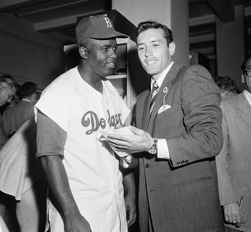 Jimmy Piersall, right, interviews Jackie Robinson in the Brooklyn Dodgers&#39; dressing room at Ebbets field in the borough of Brooklyn in New York, Sept. 30, 1955. &#40;AP Photo&#41; <span class=meta>(AP Photo&#47; Anonymous)</span>