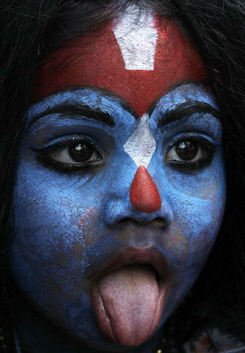 "<div class=""meta ""><span class=""caption-text "">A young girl dresses as Hindu goddess ""Kali"" as people celebrate ""Gudi Padwa"" or the Marathi new year, in Mumbai, India, Thursday, April 11, 2013. (AP Photo/Rajanish Kakade)</span></div>"