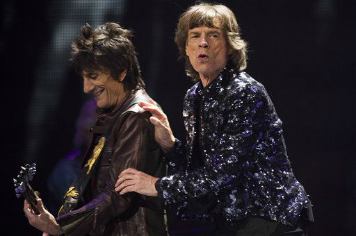 Ronnie Woods, left, and Mick Jagger of The Rolling Stones perform in concert on Saturday, Dec. 8, 2012 in New York. &#40;Photo by Charles Sykes&#47;Invision&#47;AP&#41; <span class=meta>(Photo&#47;Charles Sykes)</span>