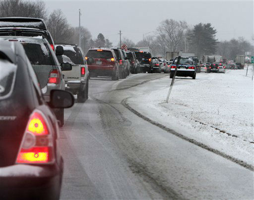 Cars are stuck in traffic as a winter storm arrives , Friday, Feb. 8, 2013 in Newington, N.H. Snow began to fall around the Northeast on Friday at the start of what&#39;s predicted to be a massive, possibly historic blizzard, and residents scurried to stock up on food and supplies ahead of the storm. &#40;AP Photo&#47;Jim Cole&#41; <span class=meta>(AP Photo&#47; Jim Cole)</span>