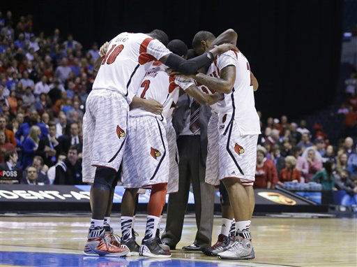 Louisville players huddle after guard Kevin Ware was taken out of the game after an injury during the first half of the Midwest Regional final against Duke in the NCAA college basketball tournament, Sunday, March 31, 2013, in Indianapolis. &#40;AP Photo&#47;Darron Cummings&#41; <span class=meta>(AP Photo&#47; Darron Cummings)</span>