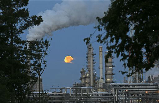 The larger-than-normal full moon referred to as Supermoon is seen setting beyond a refinery in Norco, La., Sunday, June 23, 2013. The larger than normal moon called the &#34;Supermoon&#34; happens only once this year as the moon on its elliptical orbit is at its closest point to earth and is 13.5 percent larger than usual. &#40;AP Photo&#47;Gerald Herbert&#41; <span class=meta>(AP Photo&#47; Gerald Herbert)</span>