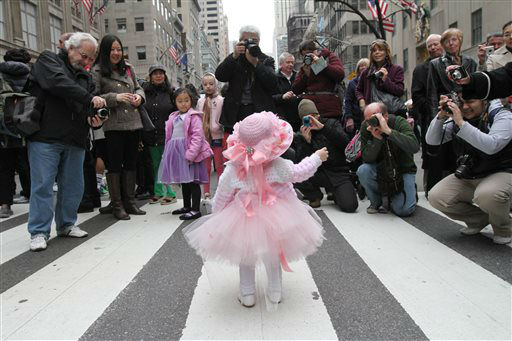 Eighteen-month-old Ariana Simmons, of New York, center, poses for photographs on New York&#39;s Fifth Avenue as she takes part in the Easter Parade Sunday March 31, 2013. &#40;AP Photo&#47;Tina Fineberg&#41; <span class=meta>(AP Photo&#47; Tina Fineberg)</span>