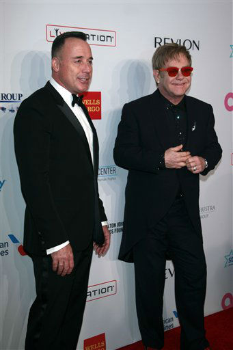 David Furnish and Elton John arrive at the Elton John AIDS Foundation&#39;s 12th Annual &#34;An Enduring Vision&#34; benefit gala at Cipriani Wall Street on Tuesday, Oct. 15, 2013 in New York. &#40;Photo by Carlo Allegri&#47;Invision&#47;AP&#41; <span class=meta>(Photo&#47;Carlo Allegri)</span>