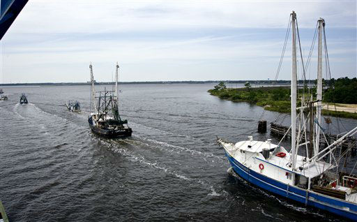 Shrimp boats and pleasure craft make their way under the Popps Ferry Bridge in Biloxi, Miss., on Monday, Aug. 27, 2012, to safer inland waters in anticipation of the arrival of Tropical Storm Isaac. The storm is expected to make landfall somewhere on the Mississippi or Louisiana coast sometime Tuesday night or early Wednesday morning. &#40;AP Photo&#47;Drew Tarter&#41; <span class=meta>(AP Photo&#47; Drew Tarter)</span>