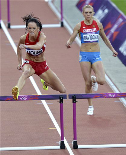 United States&#39; Georganne Moline, left, and Russia&#39;s Irina Davydova compete in a women&#39;s 400-meter hurdles heat during the athletics in the Olympic Stadium at the 2012 Summer Olympics, London, Sunday, Aug. 5, 2012. &#40;AP Photo&#47;Martin Meissner&#41; <span class=meta>(AP Photo&#47; Martin Meissner)</span>