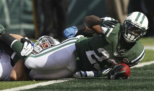 New York Jets running back Shonn Greene &#40;23&#41; celebrates after scoring a touchdown as he is tackled by Indianapolis Colts&#39; Tom Zbikowski &#40;28&#41; during the first half of an NFL football game Sunday, Oct. 14, 2012 in East Rutherford, N.J. &#40;AP Photo&#47;Seth Wenig&#41; <span class=meta>(AP Photo&#47; Seth Wenig)</span>