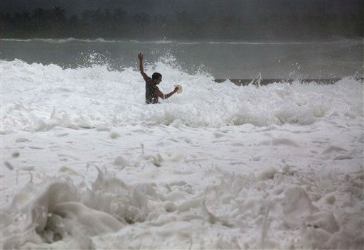 A man who was watching the sea and got pulled in by a wave, fights the current as Tropical Storm Isaac hits Baracoa, Cuba, Saturday, Aug. 25, 2012. The man got out of the water safely on his own. Tropical Storm Isaac pushed into Cuba on Saturday after sweeping across Haiti&#39;s southern peninsula. Isaac&#39;s center made landfall just before midday near the far-eastern tip of Cuba. &#40;AP Photo&#47;Ramon Espinosa&#41; <span class=meta>(AP Photo&#47; Ramon Espinosa)</span>