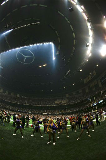 The Baltimore Ravens cheerleaders stand on the field during a power outage in the second half of the NFL Super Bowl XLVII football game between the San Francisco 49ers and the Baltimore Ravens Sunday, Feb. 3, 2013, in New Orleans. &#40;AP Photo&#47;Julio Cortez&#41; <span class=meta>(AP Photo&#47; Julio Cortez)</span>