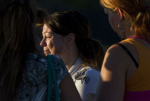 "<div class=""meta image-caption""><div class=""origin-logo origin-image ""><span></span></div><span class=""caption-text"">A woman cries outside Gateway High School where witness were brought for questioning after a gunman opened fire at a midnight premiere of The Dark Knight Rises Batman movie Friday, July 20, 2012 in Aurora, Colo. A gunman wearing a gas mask set off an unknown gas and fired into the crowded movie theater killing 12 people and injuring at least 50 others, authorities said.(AP Photo/Barry Gutierrez) (AP Photo/ Barry Gutierrez)</span></div>"