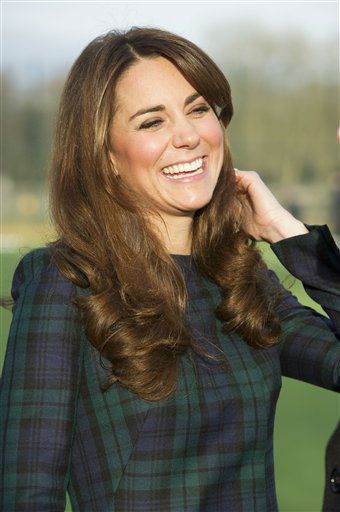 FILE - Kate, the Duchess of Cambridge seen during her visit to St. Andrew?s School, where she attended school, in Pangbourne, England, in this file photo dated Friday, Nov. 30, 2012.  The Duke and Duchess of Cambridge are very pleased to announce that the Duchess of Cambridge is expecting a baby, St James&#39;s Palace officially announced Monday Dec. 3, 2012. &#40;AP Photo&#47;Arthur Edwards, File&#41; <span class=meta>(AP Photo&#47; ARTHUR EDWARDS)</span>