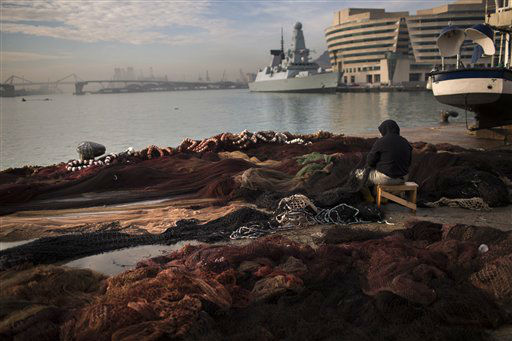 In front of the mediterranean see, a fisherman works fixing his net at the fishing port of Barcelona, Spain, Thursday, Dec. 13, 2012. The Spanish government says that the euro 39.5 billion &#40;&#36;51.3 billion&#41; in bailout funds approved by European authorities for the country&#39;s troubled banks has arrived. &#40;AP Photo&#47;Emilio Morenatti&#41; <span class=meta>(AP Photo&#47; Emilio Morenatti)</span>