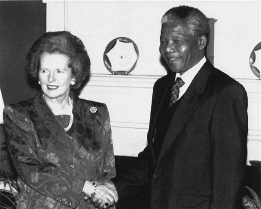 British Prime Minister Margaret Thatcher shakes hands with ANC deputy leader Nelson Mandela inside 10 Downing Street, London, on July 4, 1990, prior to talks and a luncheon. Mandela is on a three-day visit to Britain as part of an extensive international tour. &#40;AP Photo&#47;Cleaver&#41; <span class=meta>(AP Photo&#47; Martin Cleaver)</span>