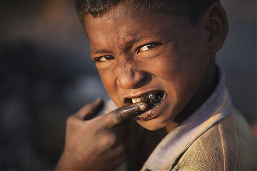 "<div class=""meta ""><span class=""caption-text "">A homeless boy cleans his teeth with coal in the morning in Jammu, India, Thursday, Nov. 8, 2012. (AP Photo/Channi Anand) (AP Photo/ Channi Anand)</span></div>"
