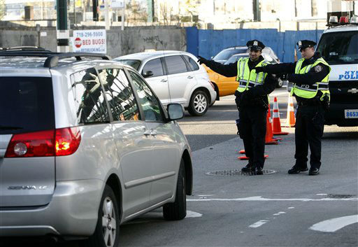 Police turn a motorist away from the Queensboro Bridge for not complying with High Occupancy Vehicle &#40;HOV&#41; restrictions in the aftermath of superstorm Sandy, Thursday, Nov. 1, 2012, in the Queens borough of New York.  &#40;AP Photo&#47;Jason DeCrow&#41; <span class=meta>(AP Photo&#47; Jason DeCrow)</span>